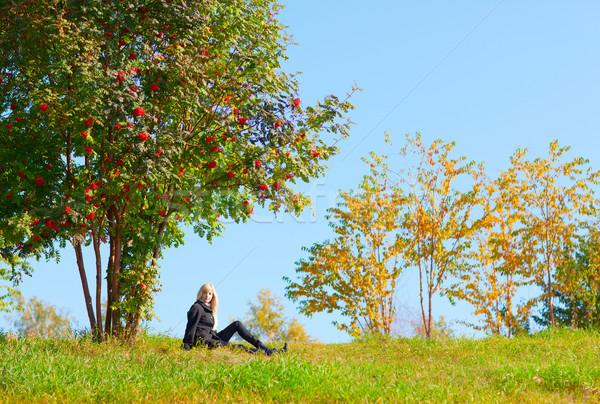 Woman under mountain ash tree Stock photo © zastavkin