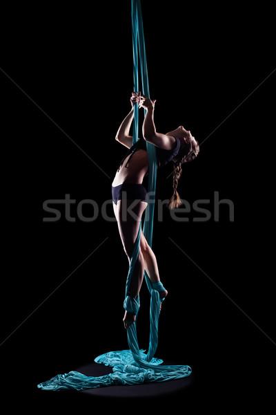 Genç kadın jimnastikçi mavi jimnastik şerit yalıtılmış Stok fotoğraf © zastavkin