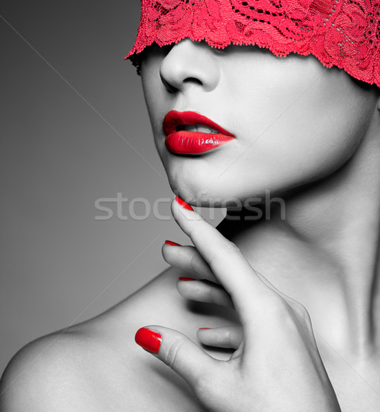 woman with red lacy ribbon on eyes Stock photo © zastavkin
