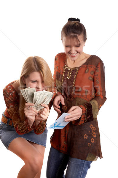 Girls with envelope and money Stock photo © zastavkin