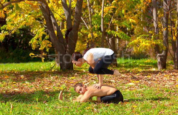 yoga bakasana on pashchimottanasane pose Stock photo © zastavkin