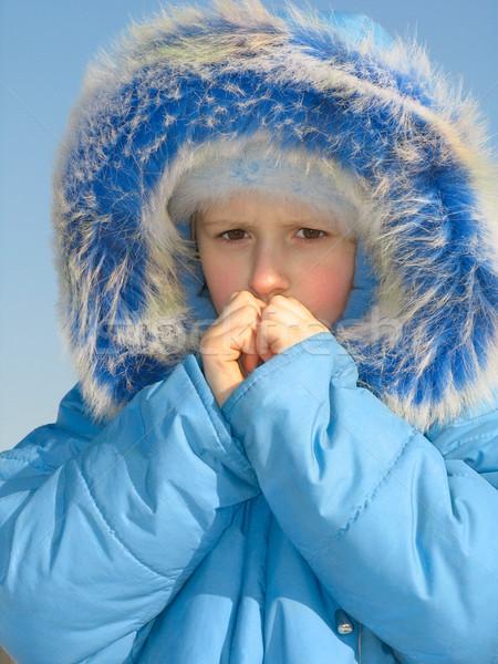 Girl trying to warm fingers Stock photo © zastavkin