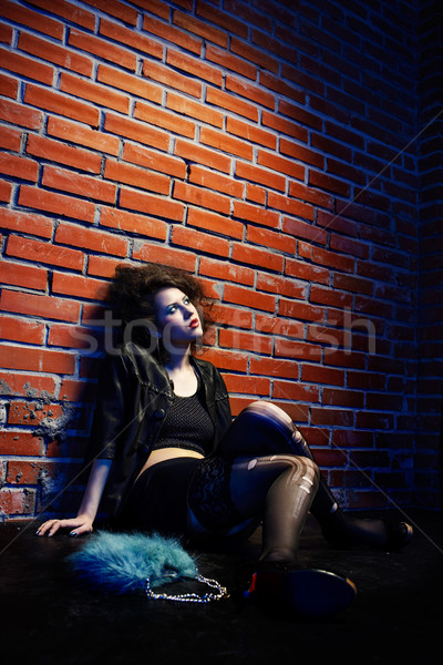 Prostituált portré lány ahogy pózol téglafal Stock fotó © zastavkin