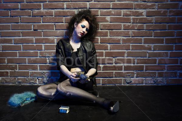 Prostituta retrato menina como posando parede de tijolos Foto stock © zastavkin