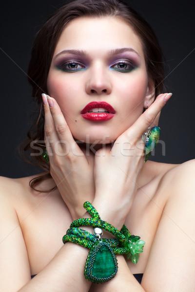 Beautiful young woman in necklace Stock photo © zastavkin