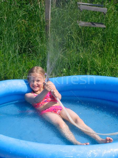 Girl playing with the watter Stock photo © zastavkin