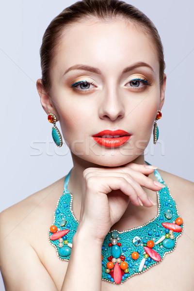 Beautiful blonde woman in bijouterie  on grey background Stock photo © zastavkin