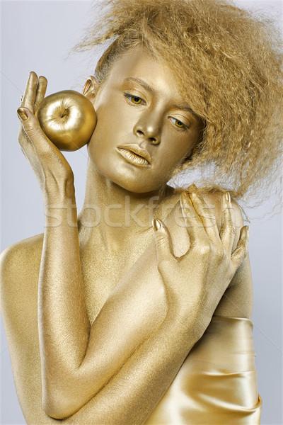 Or fille pomme portrait posant mains Photo stock © zastavkin