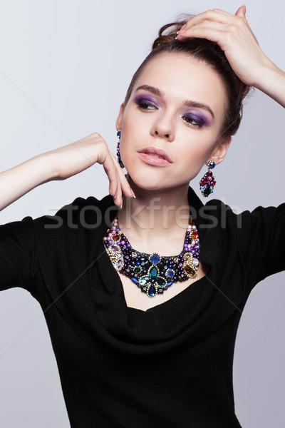 Fiatal nő csecsebecsék szürke fekete ruha kéz arc Stock fotó © zastavkin