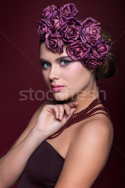 Beautiful young woman with artificial rouses on head necklace an Stock photo © zastavkin