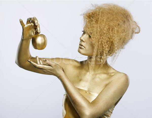 golden girl with apple Stock photo © zastavkin