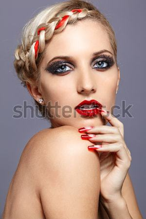oman with red lacy ribbon on eyes Stock photo © zastavkin