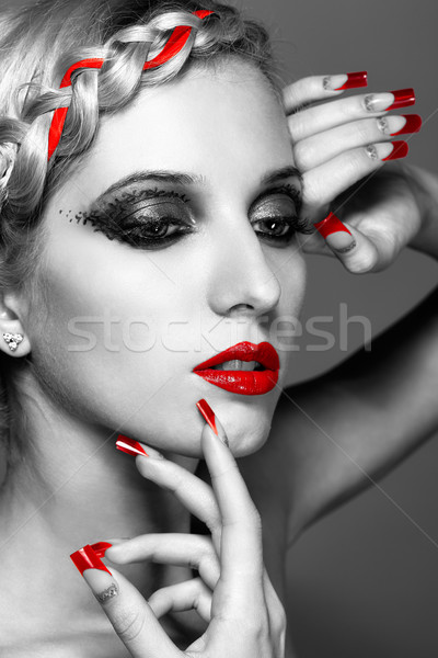 Young woman with red nails Stock photo © zastavkin