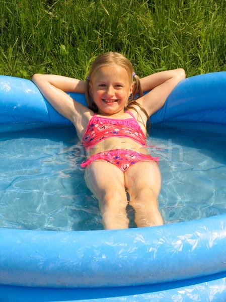 Girl in the swimming-pool Stock photo © zastavkin