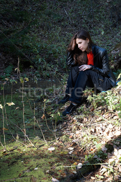Girl seating near pond Stock photo © zastavkin