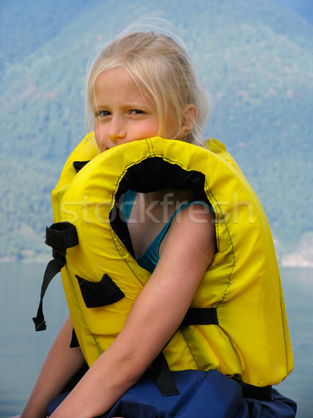 Girl in the yellow air-jacket Stock photo © zastavkin