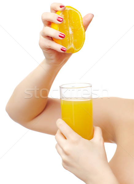 hands squeezing out orange Stock photo © zastavkin