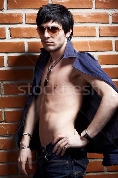 man near brick wall Stock photo © zastavkin