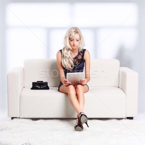 blond girl on sofa Stock photo © zastavkin