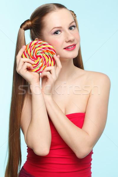 Young woman with lollipop Stock photo © zastavkin