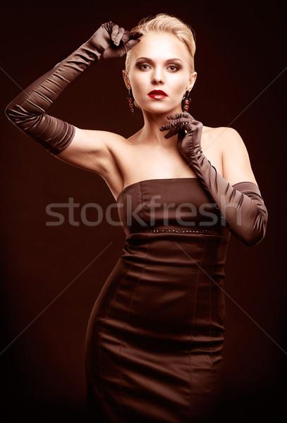 Blonde woman in black dress Stock photo © zastavkin
