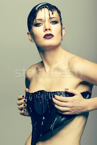 Woman in dress of molten vinil disk Stock photo © zastavkin