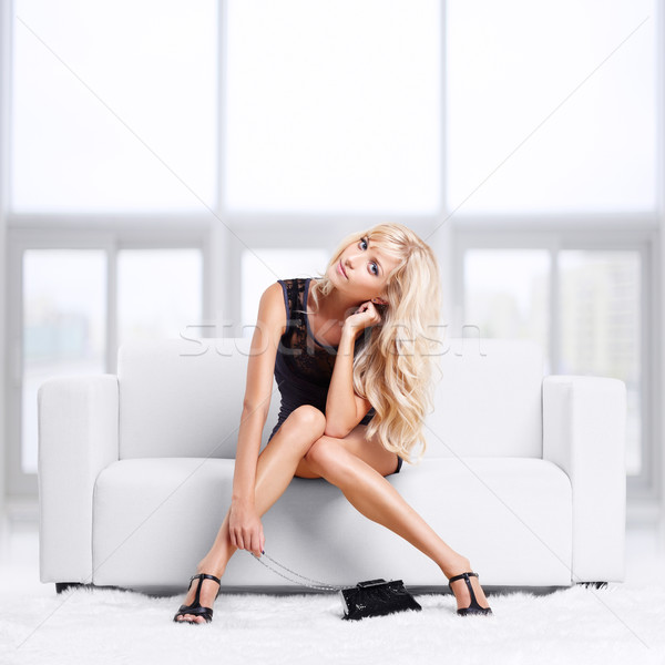 blond girl on sofa Stock photo © zastavkin