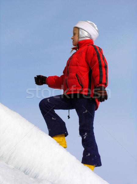 Girl on ice slope Stock photo © zastavkin