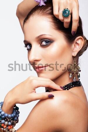 woman with teal beads Stock photo © zastavkin