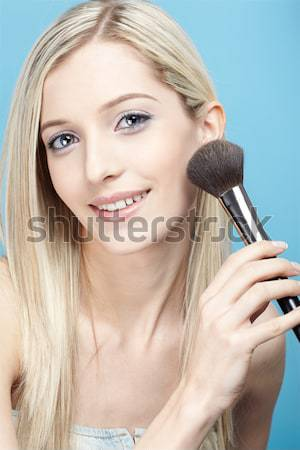 woman applying blusher Stock photo © zastavkin