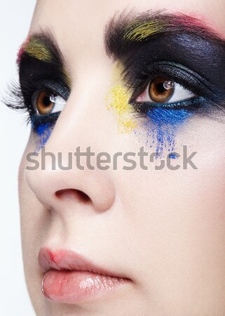 Woman with false feather eyelashes makeup Stock photo © zastavkin