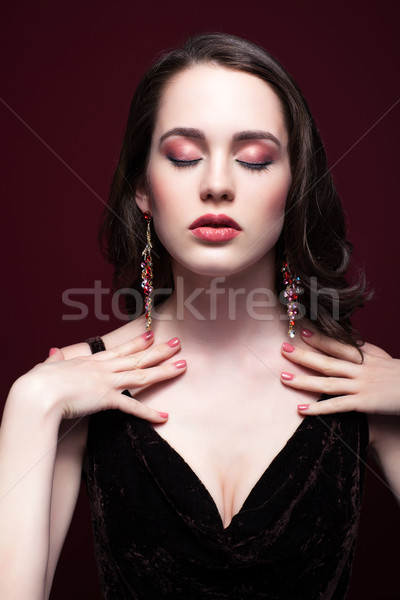 Young beautiful woman with closed eyes on red marsala background Stock photo © zastavkin