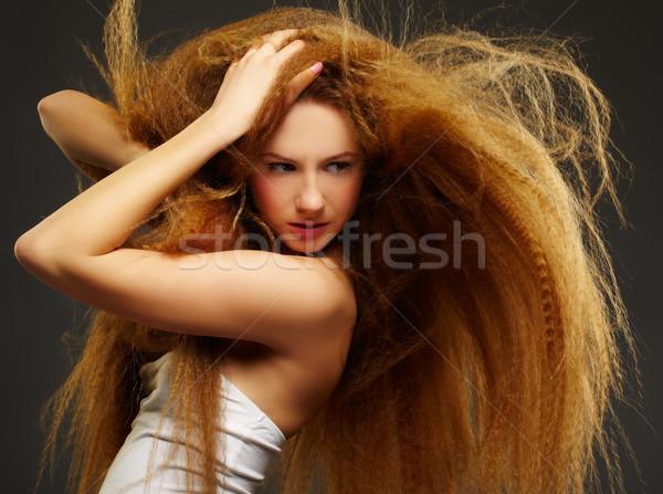 long-haired curly redhead woman Stock photo © zastavkin
