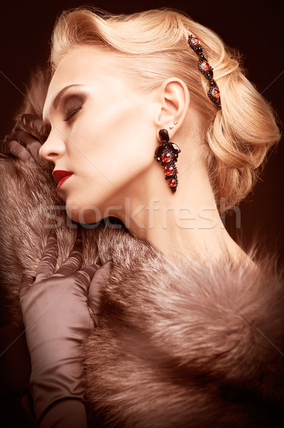 Blonde woman in fur Stock photo © zastavkin