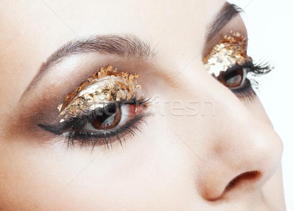 Altın göz makyajı atış kadın yüz Stok fotoğraf © zastavkin