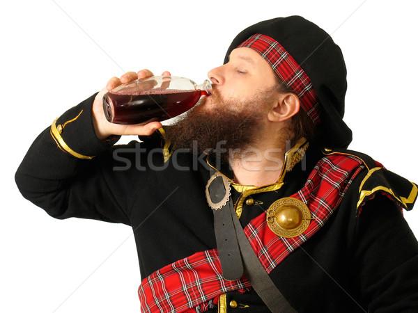 Scottish warrior drinking wine Stock photo © zastavkin