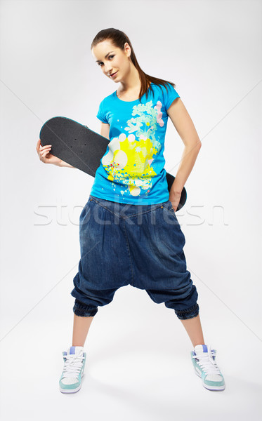 Fille skateboard portrait belle extrême gris Photo stock © zastavkin