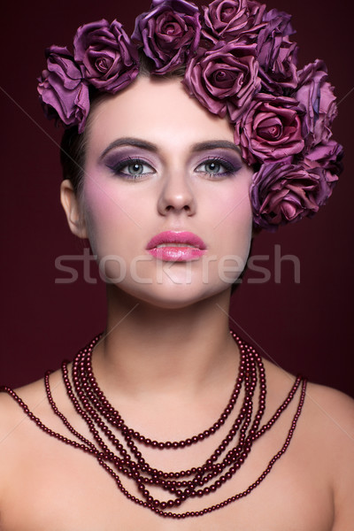 Beautiful young woman with artificial rouses on head necklace on Stock photo © zastavkin