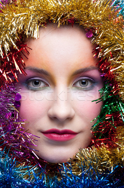 Woman in tinsel Christmas costume Stock photo © zastavkin