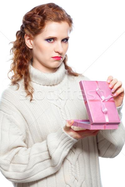 Portrait of a sad girl with a gift Stock photo © zastavkin