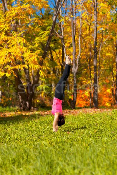 Yoga Adha mukha vrikshasana pose Stock photo © zastavkin