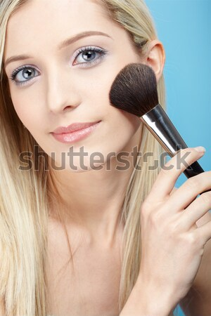 Makeup artist applying eyeshadow Stock photo © zastavkin