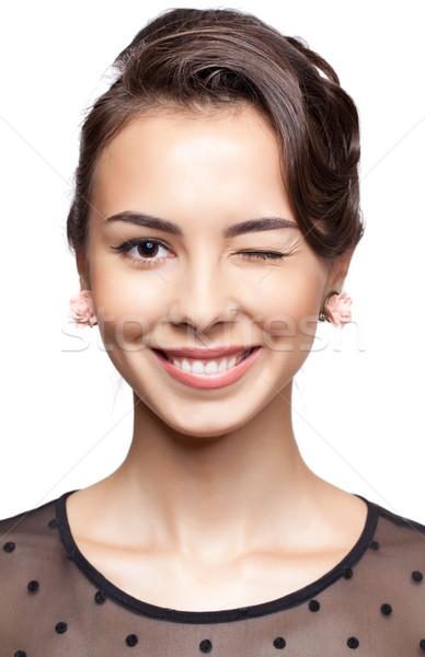 Młoda kobieta dać mrugnięcie młodych szczęśliwy uśmiechnięta kobieta Zdjęcia stock © zastavkin