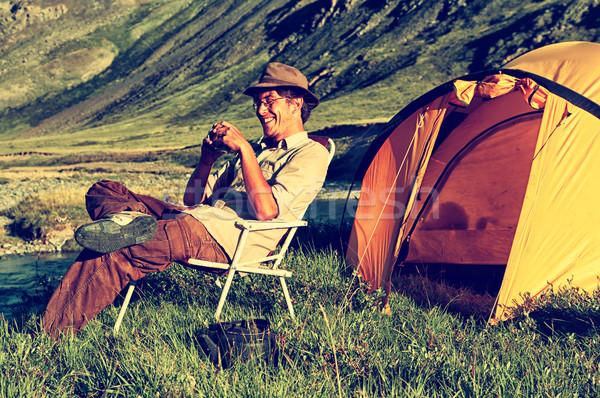 Happy tourist in camp Stock photo © zastavkin