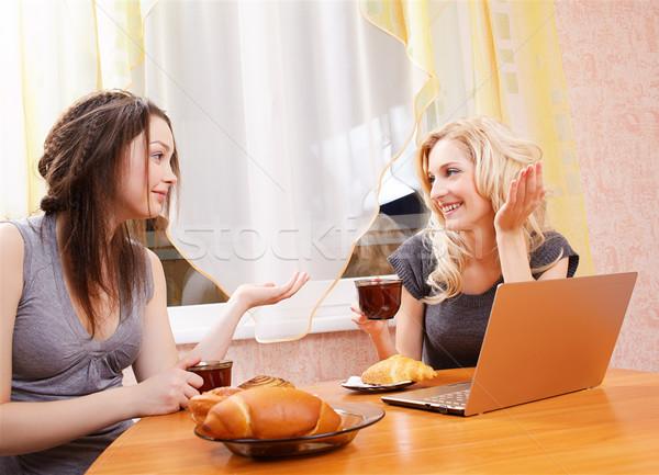 Stock photo: two girls drinking tea