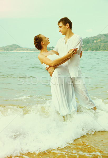 Instagram colorized vintage couple on beach portrait  Stock photo © zastavkin