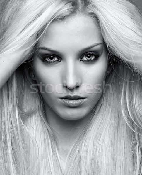Blonde young woman Stock photo © zastavkin