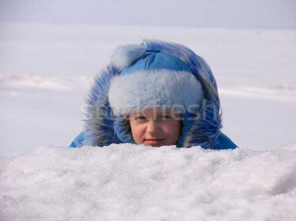 Young girl hiding after snowdrift  Stock photo © zastavkin