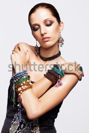 Gyönyörű barna hajú nő portré fiatal nő kezek Stock fotó © zastavkin