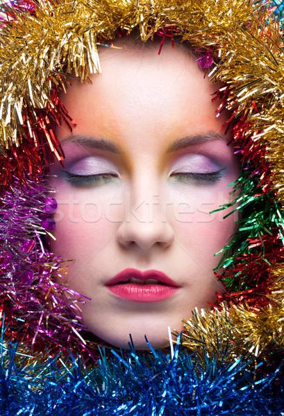 Woman in tinsel Christmas costume Stock photo © zastavkin